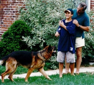 1987 - Ben and Bill Osborn with family pet Bern. )